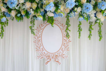 Beautiful backdrop flowers arrangement and empty tag for your name ready for wedding ceremony.