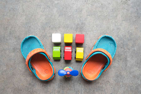 Shoes for little boy and wooden toy. Educational developing toys concept