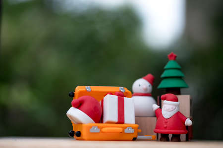 Santa Claus and gift coming to the village to give children a gift, Merry Christmas and Happy New Year Stock Photo