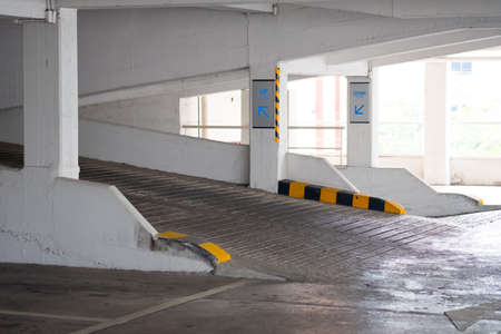 Entry view of the ramp towards the car park in a modern apartment house.