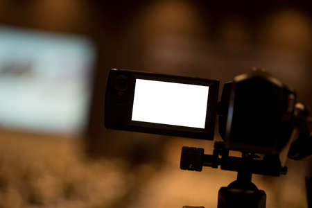 Video camera set record audience in conference hall seminar event. Journalism industry, or news reporter concept Stock Photo