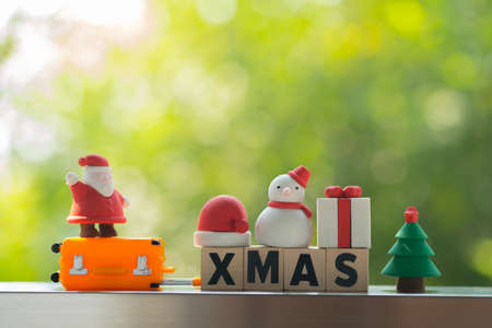 Wooden letters spelling XMAS and toy. Image for christmas and happy new year decoration celebrate concept