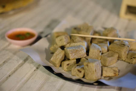 Keropok lekor made of fish served with chili sauce 스톡 콘텐츠