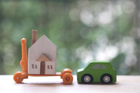 Miniature car and houses for dreaming everybody want to owner. Property or Assets for future planning stability can be exchanged for life. Saving or real estate investment concept