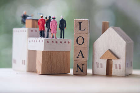 Miniature people contact and agreement banking to contact for approve home loans. Concept of the financial loans between the lender and the borrower. Secured and mortgage loan.