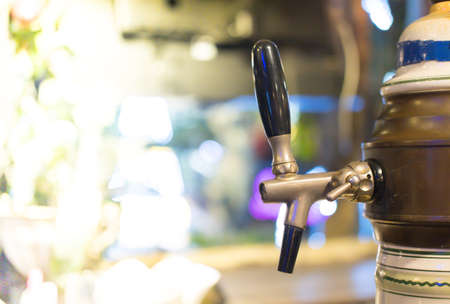 Close up of metallic beer taps in a bar