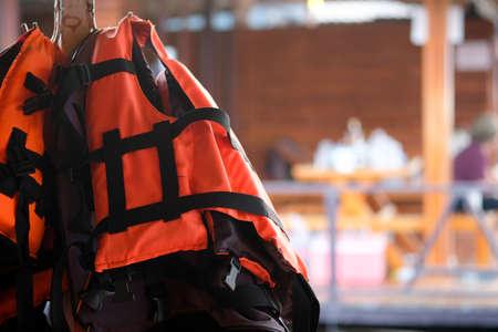 Life jacket hanging in floating hotel houses on dam at Kanchanaburi, Thailand