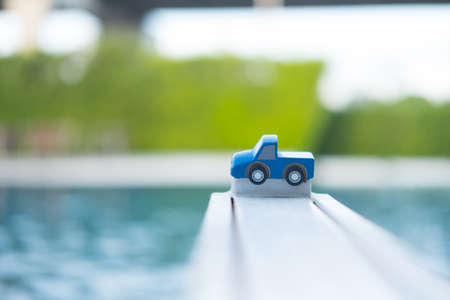 A little toy pickup truck with pool background Stock Photo