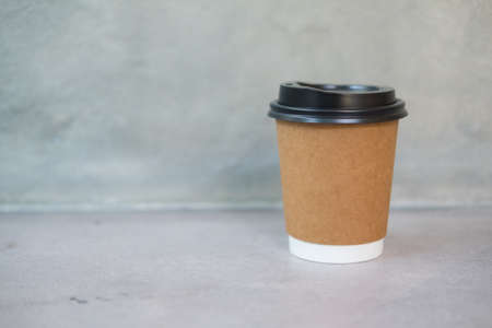 Coffee paper brown cup with a black lid