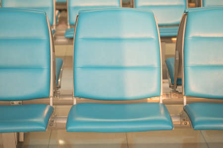 Blue seat waiting for departure passengers in airport Imagens