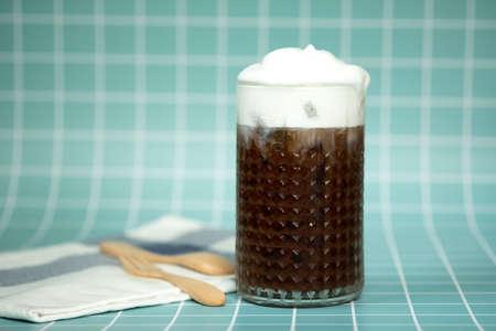 Iced mocha coffee with milk foam on top