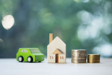 Home car loan and cost of living for investment real estate concept. Saving mortgage new house leasing credit in world of risk