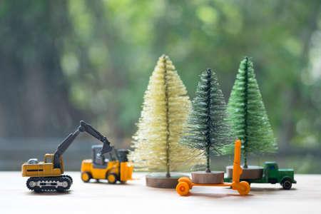 Excavator toy model move Christmas tree end of season