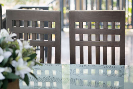 Detail of chairs made of wood at restaurant in rustic style 版權商用圖片