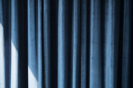 Beautifully draped blue curtain decoration in room