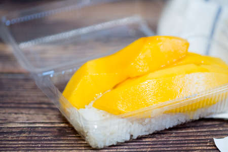 Yellow mango and sticky rice is popular traditional dessert of Thailand