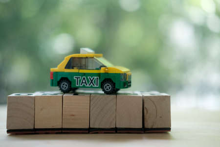 Toy model of Thai personal Taxi-Meter cab, personal tran. Taxi passengers or tourists in Thailand. can ask directions and a place to travel. Travel in Bangkok Thailand Banco de Imagens