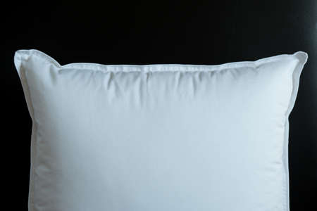 Close-up of white pillow isolated on a black background. Bed dress, pillow for sleeping. Reklamní fotografie - 122407335