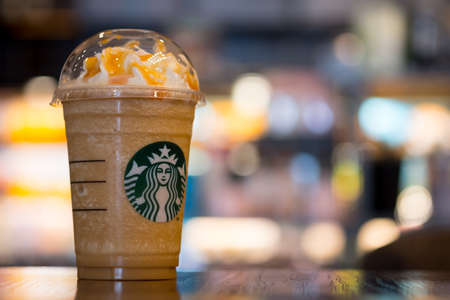 BANGKOK, THAILAND - April 6, 2019: Starbuck coffee Frappuccino on table, famous coffee brand franchise originated in USA Editorial