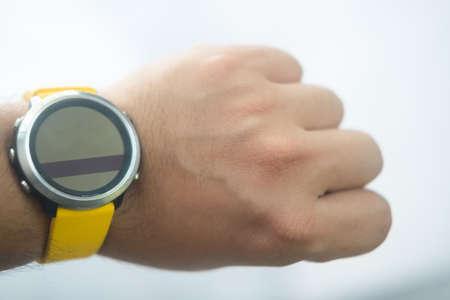Modern smart watch with empty screen in man wrist