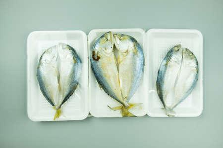 Raw mackerel fish steamed in foam tray with plastic wrap foam 写真素材