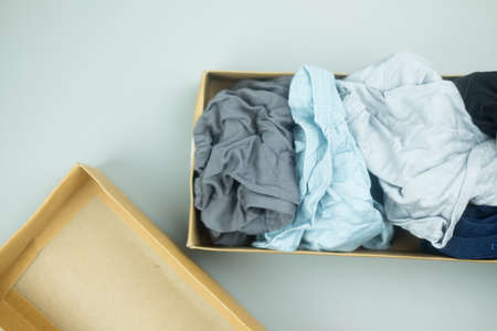 Many color men underwear in brown paper box package
