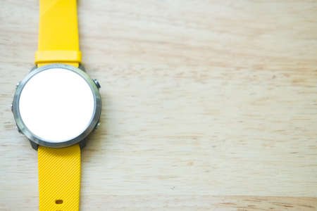 Modern smart watch with empty screen and yellow watch strap Stock Photo