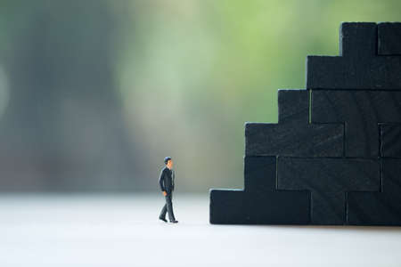 Miniature people: Businessman going step to ranking business. puzzle pieces, Concept of business success and the winner to business