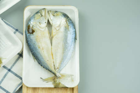 Two of steamed mackerel fish in foam white tray (local fish in Asian Thailand accent is PLA-TO)