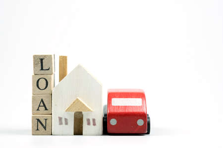 Wooden home and car model with wooden blocks with words of loan. Saving or loan and mortgage new house or new car for family financial.