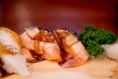 Foie Gras on top salmon sushi, close up. Japan restaurant menu