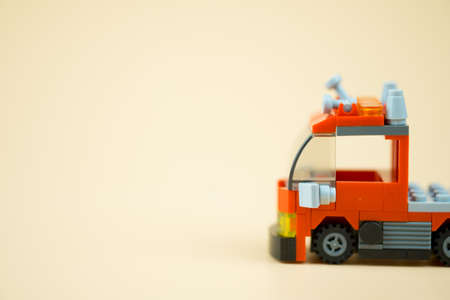 Red toy firefighter car, concept of public benefit