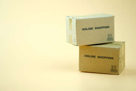 Miniature cardboard boxes. Concept of online orders. Delivery of the order from the online store