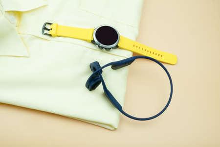 Top view of men gadget, headphones and smart watches