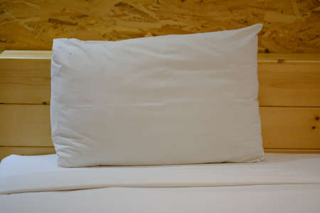 White quilted pillow in bed at hotel