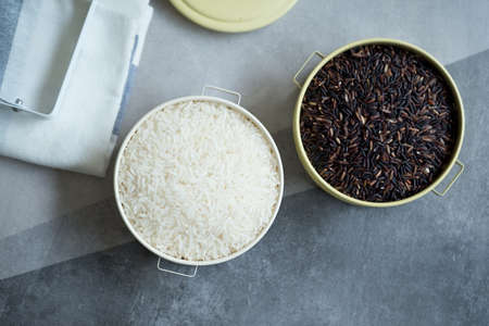 Healthy organic rice: Riceberry Rice and Jasmine rice in Thai Food carrier style