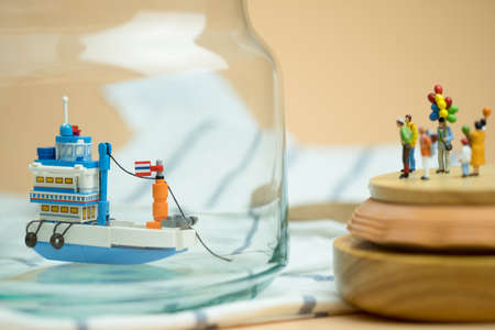 Miniature people: Passenger waiting generic Thai fishing ship or tourist ship modified from fishing ship for go to destination. Travel in Thailand. Concept summer travel