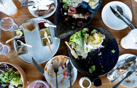 Top view of a table after eating healthy food together  in the restaurant. Concept of group of people dining. Enjoy eating. Imagens