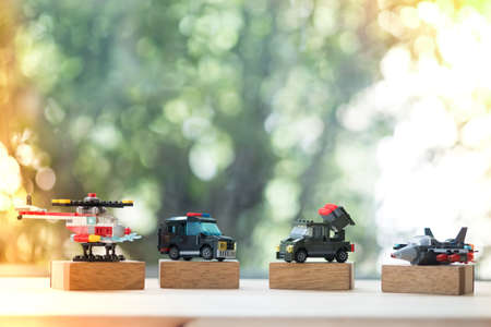 Miniature plastic toy military equipment vehicles weapons with nature background