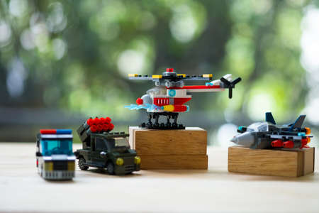 Miniature toy military equipment vehicles weapons with nature background