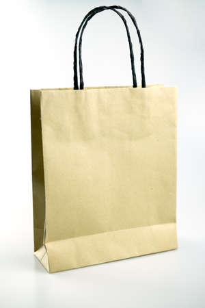 Shopping bag made from brown recycled paper. Add your own design or logo. Stock Photo - 128831348