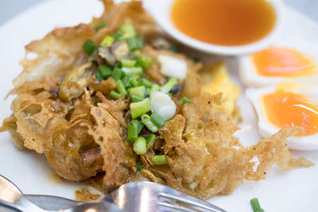 Mussel omelette or crisp fried mussel pancakes. Delicious of Thai food. Reklamní fotografie - 128831354
