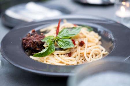 Spaghetti stir fried with spicy pork (Thai language Pad Kee Mao)
