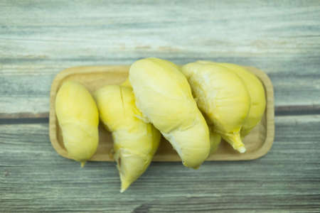 Beautiful yellow durian on wooden tray, ready to eat Stock Photo