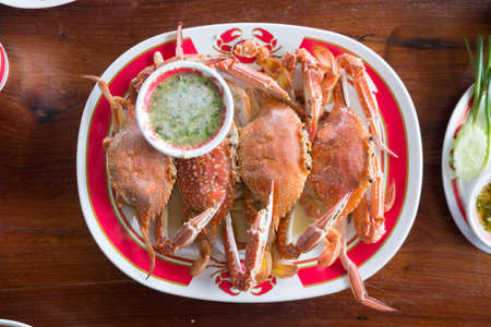 Steamed crab with seafood sauce. Seafood in Thailand Фото со стока