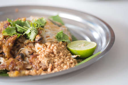 Fried mussel pancakes and Pad Thai served mix in dish