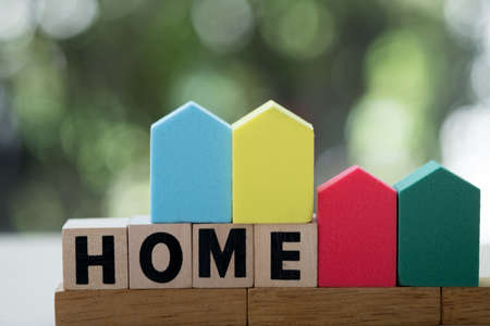 Wooden block word with HOME. The concept of buying and selling real estate, rental housing, Home protection, Home protection