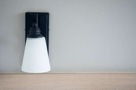 White lamp against the gray wall in living room