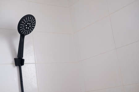 Black colour shower head in bathroom. Simple stylish and modern home interior design.