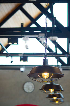 Modern lamps hanging on the ceiling. Coffee shop interior.